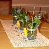 Fresh greenery and rubber duckies for the table.